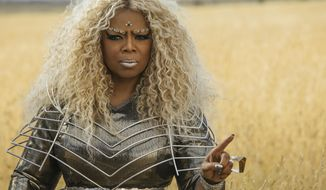 "This image released by Disney shows Oprah Winfrey in a scene from ""A Wrinkle In Time."" (Atsushi Nishijima/Disney via AP)"