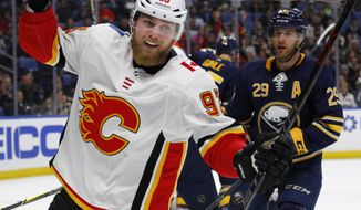 Calgary Flames forward Sam Bennett (93) celebrates his goal during the first period of an NHL hockey game against the Buffalo Sabres, Wednesday, March. 7, 2018, in Buffalo, N.Y. (AP Photo/Jeffrey T. Barnes)