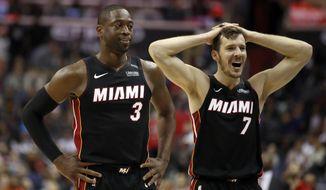 Miami Heat guards Dwyane Wade (3) and Goran Dragic (7), from Slovenia, react during the overtime portion an NBA basketball game against the Washington Wizards, Tuesday, March 6, 2018, in Washington. The Wizards won 117-113. (AP Photo/Alex Brandon)