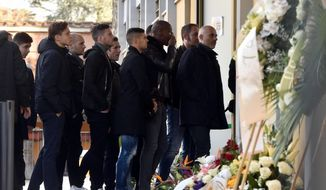 Fiorentina soccer team's players arrive to pay their tribute to their teammate Davide Astori at the Coverciano Sports Center, near Florence, Italy, Wednesday, March 7, 2018. The 31-year-old Astori was found dead in his hotel room on Sunday after a suspected cardiac arrest before his team was set to play an Italian league match at Udinese. (Maurizio Degl'Innocenti/ANSA via AP)