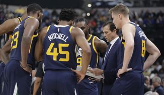 Utah Jazz coach Quin Snyder talks to his team during the first half of an NBA basketball game against the Indiana Pacers, Wednesday, March 7, 2018, in Indianapolis. (AP Photo/Darron Cummings)