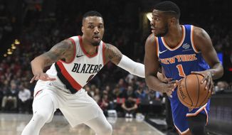 New York Knicks guard Emmanuel Mudiay tries togged past Portland Trail Blazers guard Damian Lillard during the first half of an NBA basketball game in Portland, Ore., Tuesday, March 6, 2018. (AP Photo/Steve Dykes)