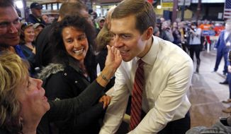 In this March 6, 2018, photo, Conor Lamb, the Democratic candidate for the March 13 special election in Pennsylvania's 18th Congressional District, greets supporters during a rally at the Carpenter's Training Center in Collier, Pa. (AP Photo/Gene J. Puskar)