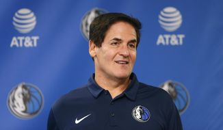 FILE - In this Monday, Feb. 26, 2018, file photo, Dallas Mavericks owner Mark Cuban stands on stage before a news conference in Dallas. Cuban is denying a 2011 allegation of sexual assault after a weekly alternative newspaper in Oregon published details of a case that prosecutors didn't pursue, saying they didn't believe there was evidence to support the claim. (AP Photo/Ron Jenkins, File)