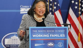 FILE - In this June 23, 2014, file photo, Tina Tchen, chief of staff to first lady Michelle Obama, speaks at The White House Summit on Working Families at a hotel in Washington. Tchen will head The Recording Academy's new task force focused on inclusion and diversity, the academy announced Tuesday, March 6, 2018. (AP Photo/Charles Dharapak, File)