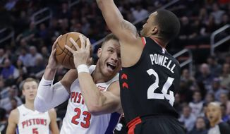 Detroit Pistons forward Blake Griffin (23) looks to shoot as Toronto Raptors forward Norman Powell defends during the first half of an NBA basketball game Wednesday, March 7, 2018, in Detroit. (AP Photo/Carlos Osorio)