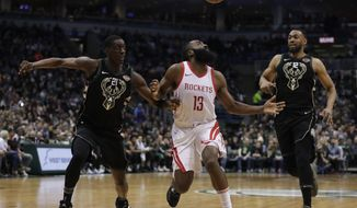 Houston Rockets' James Harden loses the ball between Milwaukee Bucks' Tony Snell and Jabari Parker during the first half of an NBA basketball game Wednesday, March 7, 2018, in Milwaukee. (AP Photo/Morry Gash)