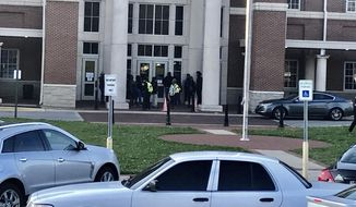 Authorities investigate the scene where a shooting occurred at Huffman High School, Wednesday, March 7, 2018, in Birmingham, Ala. Birmingham Interim Police Chief Orlando Wilson said at a news conference that authorities are seeking to determine whether the shooting Wednesday at the Alabama high school was accidental or if a gun since recovered by investigators was intentionally discharged. (Carol Robinson/AL.com via AP)
