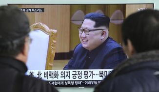 """People watch a TV screen showing North Korean leader Kim Jong Un at the Seoul Railway Station in Seoul, South Korea, Wednesday, March 7, 2018. After years of refusal, North Korean leader Kim Jong Un is willing to discuss the fate of his atomic arsenal with the United States and has expressed a readiness to suspend nuclear and missile tests during such talks, a senior South Korean official said Tuesday. Korean letters read: """"Positive evaluation for denuclearization of North Korea."""" (AP Photo/Ahn Young-joon)"""