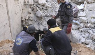 This photo released Feb. 20, 2018 by the Syrian Civil Defense group known as the White Helmets, shows members of the Syrian Civil Defense group working to remove victims from under the rubble of a damaged shelter that was hit in airstrikes and shelling by Syrian government forces, in Ghouta, a suburb of Damascus, Syria. Thousands of Syrians huddle in basements and underground shelters across eastern Ghouta, outside Damascus, hiding from the horror raining down from Syrian army jets that almost never leave the skies. (Syrian Civil Defense White Helmets via AP)