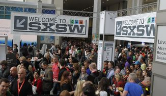 FILE - In this March 9, 2013, file photo, SXSW Interactive and Film Festival attendees crowd the Austin Convention Center in Austin, Texas. (AP Photo/Jack Plunkett, File)