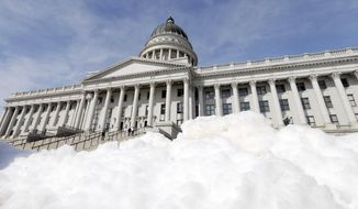 The Utah State Capitol is shown Wednesday, March 7, 2018, in Salt Lake City. Utah lawmakers are using their last two days of the legislative session to finalize a $16.7 billion budget plan that includes $10 million to help tackle homelessness and $8.5 million to get the state's Winter Olympics facilities ready to bid for the games again. (AP Photo/Rick Bowmer)
