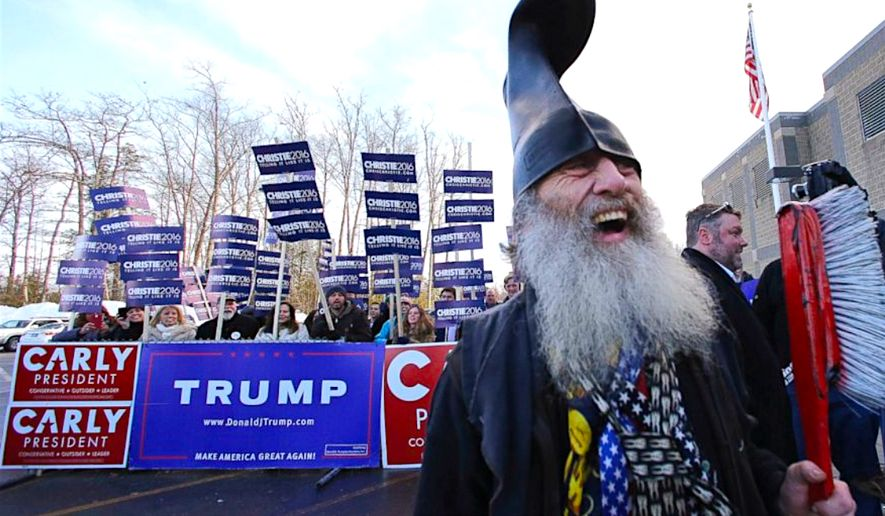 Independent presidential hopeful Vermin Supreme whoops it up on the 2016 campaign trail in New Hampshire, standing before a wall of campaign signs from his rivals. (AP Photo)