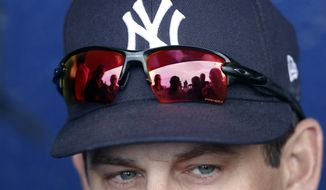 New York Yankees manager Aaron Boone speaks to reporters in the dugout before a spring training baseball game against the New York Mets, Wednesday, March 7, 2018, in Port St. Lucie, Fla. (AP Photo/John Bazemore)