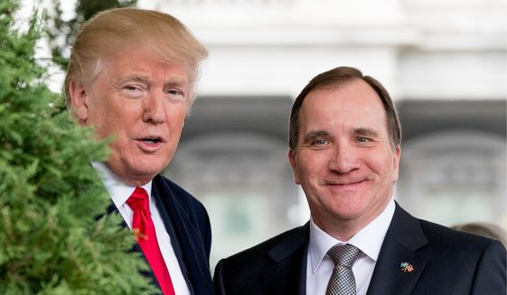 President Donald Trump greets Swedish Prime Minister Stefan Lofven as he arrives at the White House, Tuesday, March 6, 2018, in Washington. (AP Photo/Andrew Harnik)