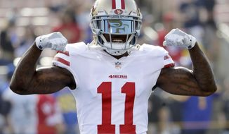 FILE - In this Dec. 31, 2017, file photo, San Francisco 49ers wide receiver Marquise Goodwin gestures as he comes onto the field before an NFL football game against the Los Angeles Rams, Sunday,, in Los Angeles. The 49ers have signed Goodwin to a three-year contract extension, Thursday, March 8, 2018. NFL Network reported that Goodwin's new contract is worth $20.3 million with $10 million in guarantees. (AP Photo/Rick Scuteri, File)