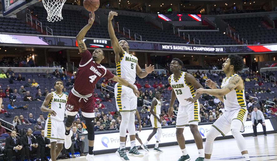 WASHINGTON, DC - MARCH 08: George Mason Patriots guard Jaire Grayer (5) tries to stop a shot by Massachusetts Minutemen guard Unique McLean (4) during a second round game of the 2018 Atlantic 10 men's basketball championship between the George Mason Patriots and the Massachusetts Minutemen on March 8, 2018, at Capital One Arena, in Washington D.C. George Mason defeated Massachusetts 80-75.  (Photo by Tony Quinn/Icon Sportswire) (Icon Sportswire via AP Images)