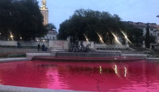 """The Revolutionary Student Front's Austin chapter on March 8 posted this photo online of a fountain at the University of Texas, which the anti-capitalist group said it turned red to symbolize the """"blood of women & all survivors"""" on International Women's Day. (Revolutionary Student Front - Austin via Twitter)"""