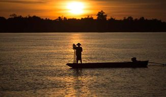 Sunset on the Mekong in Laos. (Laos official tourism Website)