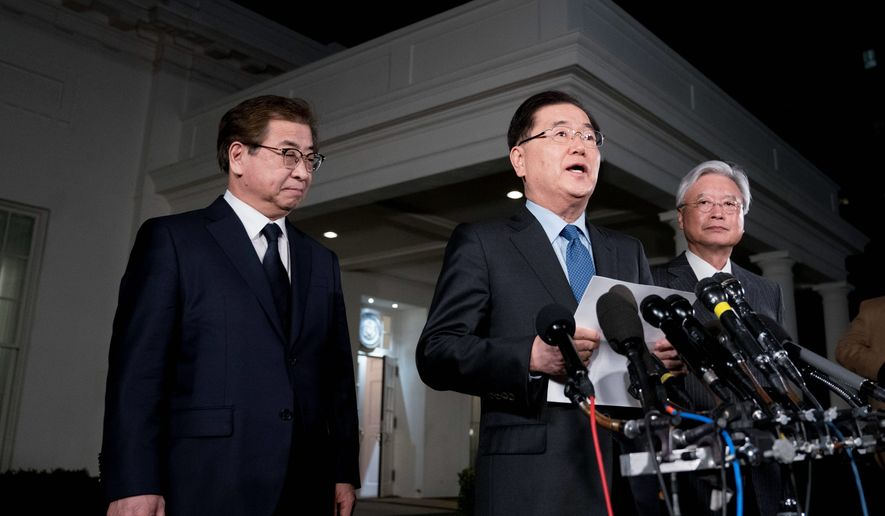 South Korean national security director Chung Eui-yong, center, accompanied by intelligence chief Suh Hoon, left, speaks to reporters at the White House in Washington, Thursday, March 8, 2018. President Donald Trump has accepted an offer of a summit from the North Korean leader and will meet with Kim Jong Un by May, a top South Korean official said Thursday, in a remarkable turnaround in relations between two historic adversaries. (AP Photo/Andrew Harnik)
