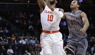 Clemson's Gabe DeVoe (10) drives past Boston College's Steffon Mitchell (41) during the second half of an NCAA college basketball game in the quarterfinal round of the Atlantic Coast Conference tournament Thursday, March 8, 2018, in New York. (AP Photo/Frank Franklin II)