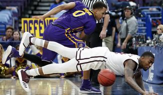 Mississippi State's Eli Wright, bottom, is unable to keep a ball in bounds as LSU's Brandon Sampson (0) watches during the first half in an NCAA college basketball game at the Southeastern Conference tournament Thursday, March 8, 2018, in St. Louis. (AP Photo/Jeff Roberson)