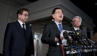 South Korean national security director Chung Eui-yong, center, speaks to reporters at the White House in Washington, Thursday, March 8, 2018, as intelligence chief Suh Hoon, left and Cho Yoon-je, the South Korea ambassador to United States, listen. President Donald Trump has accepted an offer of a summit from the North Korean leader and will meet with Kim Jong Un by May, Chung said in a remarkable turnaround in relations between two historic adversaries. (AP Photo/Andrew Harnik)