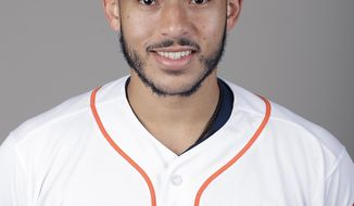 This is a 2018 photo of Carlos Correa of the Houston Astros baseball team. The Astros have renewed the contract of  Correa for the second straight year and also renewed third baseman Alex Bregman. Correa was given a $1 million salary while in the major leagues by the World Series champions. In the unlikely event he is sent to the minors, his salary would drop to $267,500. (AP Photo/John Raoux)
