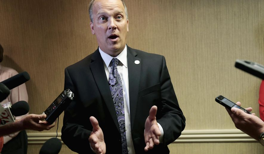FILE - In this July 29, 2016 file photo, Wisconsin Attorney General Brad Schimel speaks to reporters in Madison, Wis. Schimel is running for re-election as a Republican, but you'd never know it from his campaign launch video or website. Nowhere in the minute-long video, on his website or in his news release does Schimel, a longtime Republican and supporter of President Donald Trump, identify himself as a member of the GOP. (Michael P. King /Wisconsin State Journal via AP, File)