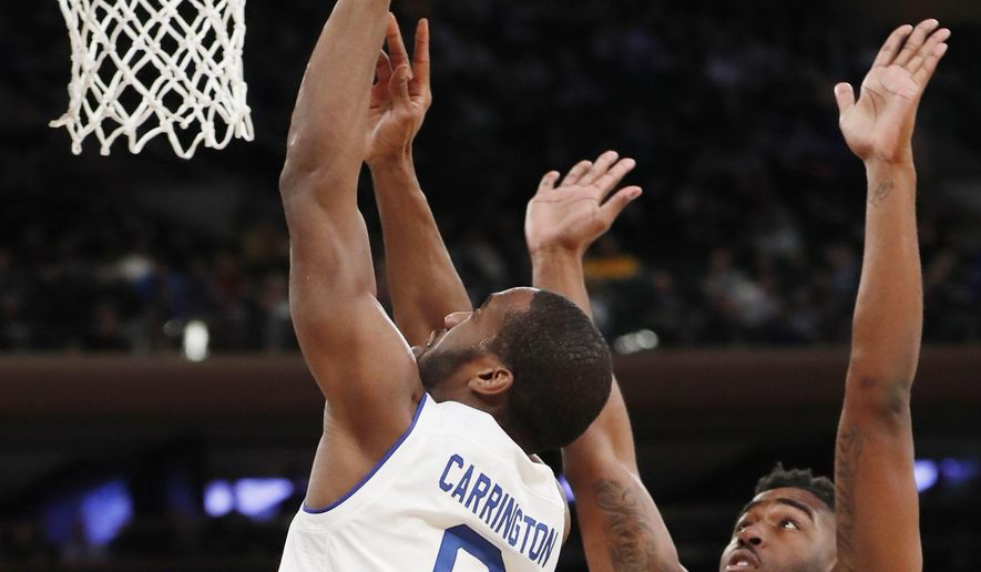 Seton Hall Khadeen Carrington (0) shoots in front of Butler's Kelan Martin (30) during the first half of an NCAA college basketball game in the Big East men's tournament quarterfinals in New York, Thursday, March 8, 2018. (AP Photo/Kathy Willens)