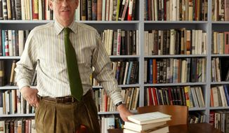 FILE - In this April 7, 2005 file photo, Jonathan Galassi, president and publisher of Farrar, Straus and Giroux, stands beside a stack of books that during his tenure have been awarded four National Book Awards and three Pulitzer Prizes, at the publishing house's New York headquarters. Galassi has chosen Mitzi Angel to succeed him as publisher later this year. (AP Photo/Kathy Willens, File)