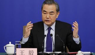 """China's Foreign Minister Wang Yi speaks during a press conference on the sidelines of the National People's Congress at the media center in Beijing, Thursday, March 8, 2018. China says its proposal for a """"dual suspension"""" of North Korean nuclear tests in return for a halt to war games by South Korea and the U.S. has proven successful. Wang on Thursday told reporters that the suspension of such activities during the recent Winter Olympic Games in Pyeongchang, South Korea showed that China's approach """"was the right prescription for the problem and created basic conditions for the improvement of inter-Korean relations."""" (AP Photo/Andy Wong)"""