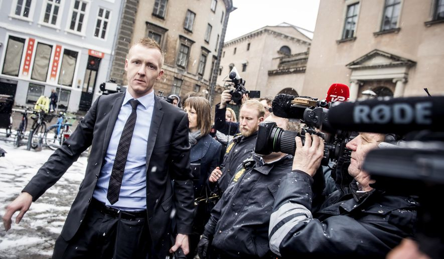 Prosecutor Jakob Buch-Jepsen arrives at the courthouse where the trial of Danish inventor Peter Madsen, charged with murdering and dismembering Swedish journalist Kim Wall aboard his homemade submarine begins, in Copenhagen, Thursday, March 8, 2018. (Mads Claus Rasmussen/Ritzau Scanpix via AP)