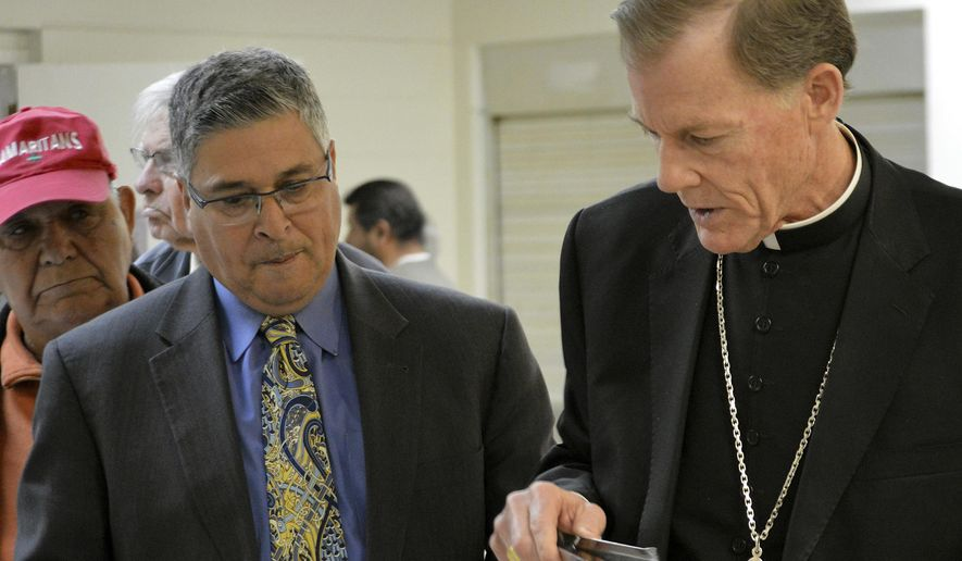 """FILE - In this Feb. 24, 2016 file photo, New Mexico Conference of Catholic Bishops executive director Allen Sanchez, left, and Santa Fe Archbishop John Wester talk before the start of an immigration forum at Our Lady of Guadalupe parish in Albuquerque, N.M. New Mexico's three Catholic bishops said the head of the New Mexico Conference of Catholic Bishops didn't accuse anyone of racism and are defending his actions in trying to push for an expansion of early childhood education programs. In an open letter Tuesday, March 6, 2018, the bishops wrote that Allen Sanchez, executive director of the group, has a deep love """"for the Gospel"""" and is an advocate for the state's poor with an extension record. (AP Photo/Russell Contreras, File)"""
