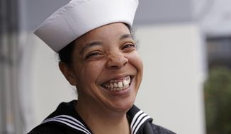 In this Jan. 18, 2018, photo, U.S. Navy YN1 Suraya Mattocks, one of the first female enlisted sailors to be selected to serve on submarines, poses for a portrait at the U.S. Naval Undersea Museum near her base in Keyport, Wash. The Navy began bringing female officers on board submarines in 2010, followed by enlisted female sailors five years later. Their retention rates are on par with those of men, according to records obtained by The Associated Press. (AP Photo/Elaine Thompson)