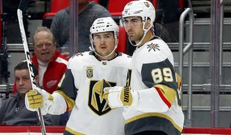 Vegas Golden Knights' Alex Tuch (89) celebrates his goal against the Detroit Red Wings with Ryan Carpenter during the first period of an NHL hockey game Thursday, March 8, 2018, in Detroit. (AP Photo/Paul Sancya)