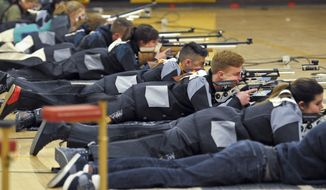 In this March 2, 2018, photo, a group of JROTC shooters compete in the prone position during the 2018 New Mexico Junior Olympic Qualifier for sport and precision air rifles at Cibola High School in Albuquerque, N.M., for the chance to compete at the National Junior Olympic Championships in Ohio in June. The National Rifle Association has given more than $7 million in grants to hundreds of U.S. schools in recent years, typically used for JROTC programs, including $126,000 given to Albuquerque schools. (Marla Brose/Albuquerque Journal via AP)