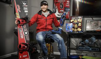 In this Dec. 22, 2017, file photo, Mike Schultz, who is preparing to compete in the 2018 Winter Paralympics in South Korea, poses for a photo in his shop in St. Cloud, Minn. (Jason Wachter/St. Cloud Times via AP, File)