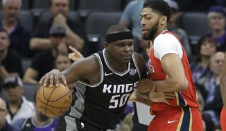New Orleans Pelicans forward Anthony Davis, right, tries to stop Sacramento Kings forward Zach Randolph, left, during the first quarter of an NBA basketball game Wednesday, March 7, 2018, in Sacramento, Calif. (AP Photo/Rich Pedroncelli)