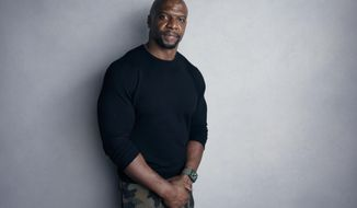 """FILE - In this Jan. 21, 2018, file photo, Terry Crews poses for a portrait to promote the film, """"Sorry to Bother You"""", at the Music Lodge during the Sundance Film Festival in Park City, Utah. Prosecutors on Wednesday, March 7, decided not to file charges against a talent agent whom Crews said groped him at a Hollywood party. (Photo by Taylor Jewell/Invision/AP, File)"""
