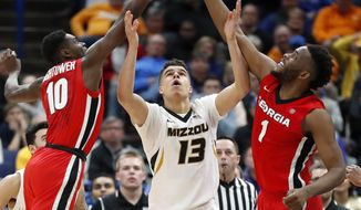 Missouri's Michael Porter Jr. (13) reaches for a rebound between Georgia's Teshaun Hightower (10) and Yante Maten (1) during the second half in an NCAA college basketball game at the Southeastern Conference tournament Thursday, March 8, 2018, in St. Louis. (AP Photo/Jeff Roberson)