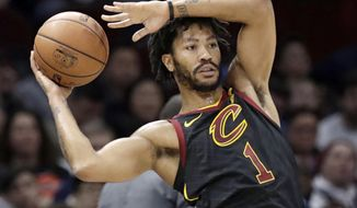 FILE - Int this Jan. 20, 2018, file photo, Cleveland Cavaliers' Derrick Rose (1) passes during the second half of an NBA basketball game against the against the Oklahoma City Thunder in Cleveland. A person familiar with the situation said Thursday, March 8, 2018, that Rose has agreed to sign with the Minnesota Timberwolves for the remainder of the season. Cleveland traded Rose to Utah, and the Jazz waived him before he played there. (AP Photo/Tony Dejak, File)