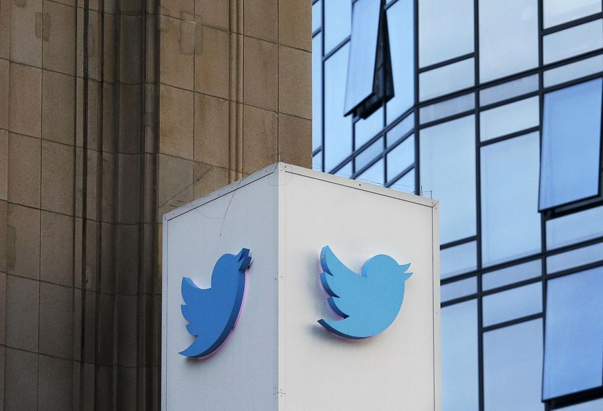 This Oct. 26, 2016 file photo shows a Twitter sign outside of the company's headquarters in San Francisco. (AP Photo/Jeff Chiu), File