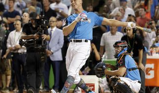 """FILE - In this July 10, 2017, file photo, New York Yankees' Aaron Judge smiles as he competes during the MLB baseball All-Star Home Run Derby, in Miami. Judge is strongly leaning toward not taking part in Home Run Derby at the All-Star Game. The 2017 AL Rookie of the Year after hitting 52 homers and driving in 114 runs won the derby last season. """"A cool experience,"""" Judge said Thursday, March 8, 2018. """"I enjoyed it all but I don't think I really needed to go out there and do it again. I won it once. One and done is good for me.""""(AP Photo/Lynne Sladky, File)"""