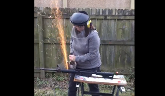 Karen Mallard, Democrat for Congress in Virginia, destroys her AR-16 in Fecebook video.