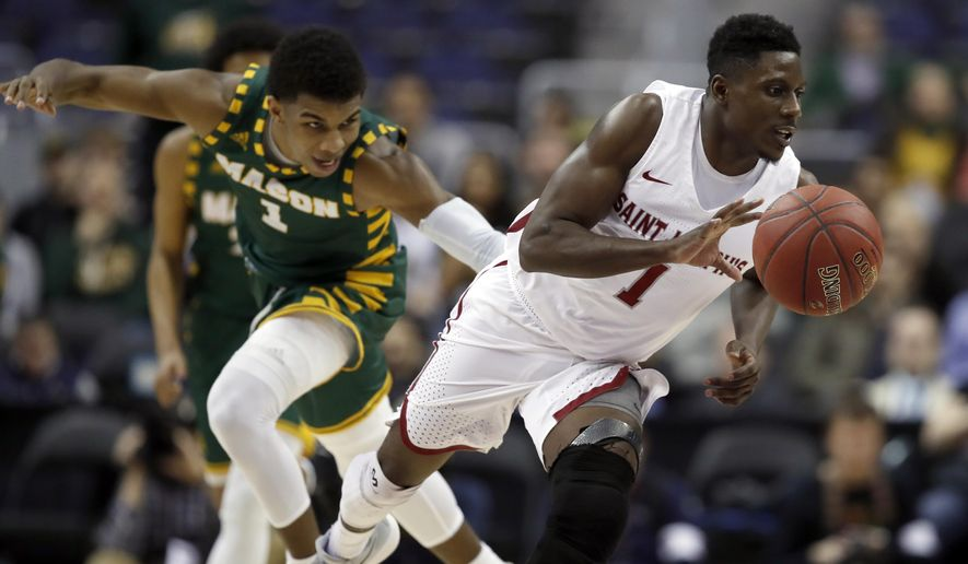 George Mason guard Justin Kier, left, pursues Saint Joseph's guard Shavar Newkirk, right, during the second half of an NCAA college basketball quarterfinal game in the Atlantic 10 Conference tournament, Friday, March 9, 2018, in Washington. Saint Joseph's won 68-49. (AP Photo/Alex Brandon)