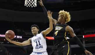 Rhode Island guard Jeff Dowtin (11) attempts a shot as VCU forward Justin Tillman (4) defends during the first half of an NCAA college basketball game in the Atlantic 10 Conference tournament, Friday, March 9, 2018, in Washington. (AP Photo/Alex Brandon)