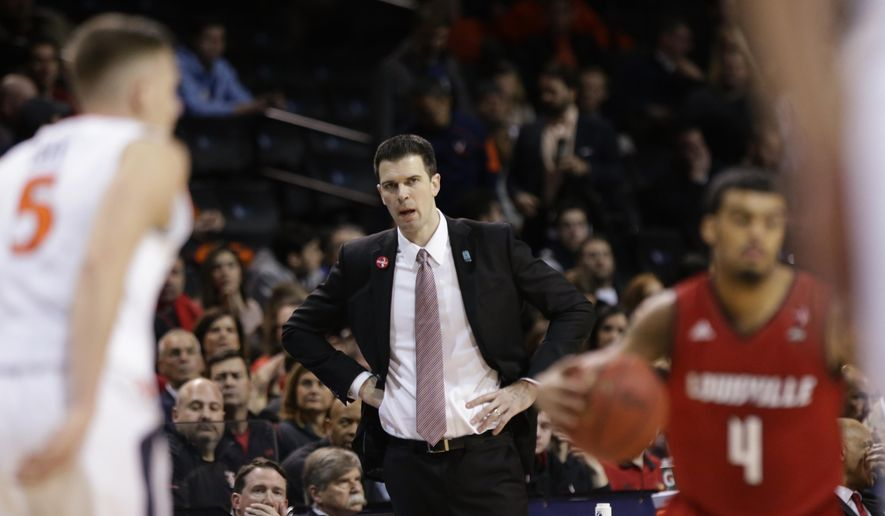 Louisville head coach David Padgett watches his team play during the first half of an NCAA college basketball game against Virginia in the quarterfinal round of the Atlantic Coast Conference tournament Thursday, March 8, 2018, in New York. (AP Photo/Frank Franklin II)  **FILE**