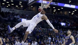 Duke guard Trevon Duval (1) misses a dunk against Notre Dame during the second half of an NCAA college basketball game in the Atlantic Coast Conference men's tournament Thursday, March 8, 2018, in New York. (AP Photo/Julie Jacobson)