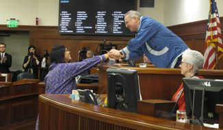 Alaska state House Speaker Bryce Edgmon, right, congratulates Rep. Tiffany Zulkosky after her swearing in on Friday, March 9, 2018, in Juneau, Alaska. Zulkosky replaces Democrat Zach Fansler in the House. Fansler resigned after being accused of hitting a woman. (AP Photo/Becky Bohrer)